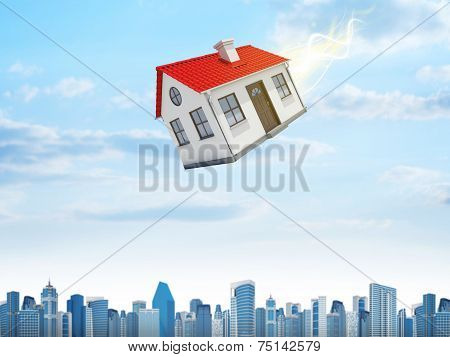 House is falling from the sky. City on background