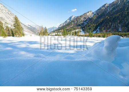 Snow fall early winter and late autumn. Alps landscape with snow capped mountains in the late autumn