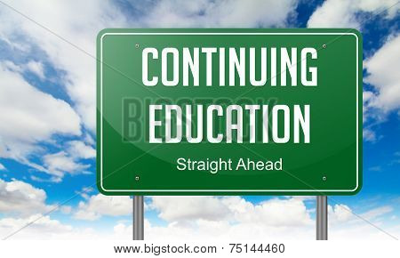 Continuing Education on Highway Signpost.