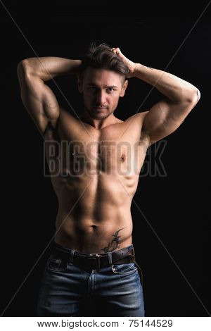 Handsome Muscular Shirtless Young Man With Hands Behind Head