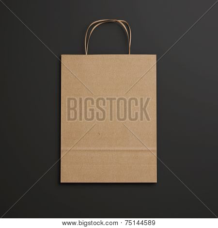 Brown Paper Bag With Handles On Black Background
