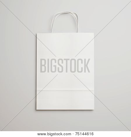 Rown Paper Bag With Handles On Light Gray Background