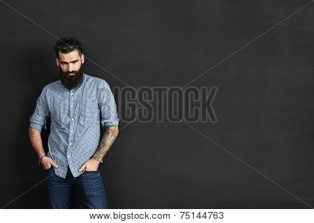 Portrait Of A Hipster On Chalkboard Background
