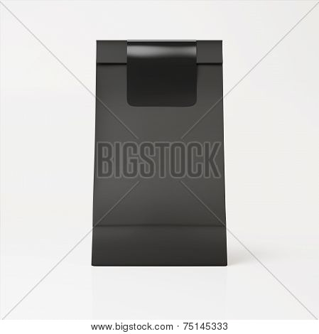 Black Paper Bag With Black Sticker On Light Background