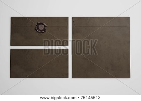 Dark Brown Envelopes On Gray Background