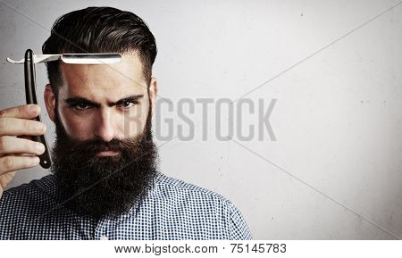 Portrait Of Brutal Man With Vintage Straight Razor