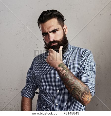 Portrait Of A Bearded Man Thinking