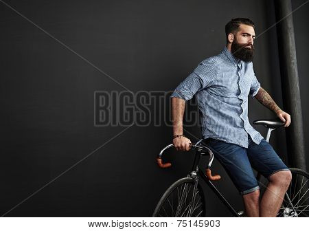 Brutal Bearded Man With Vintage Bicycle