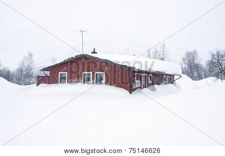 Red lodge, cabin covered of snow.