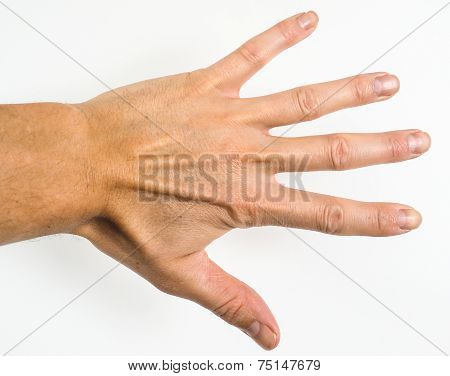 Male Person Showing Five Fingers Towards A Grey Scale Wall