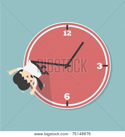 Vector Businessman Hangs On An Arrow Of Clock.