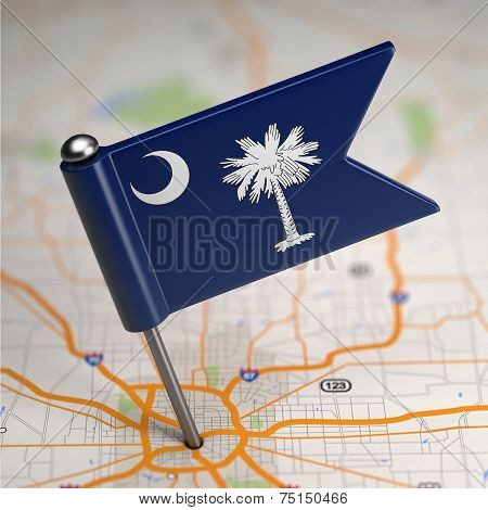 South Carolina Small Flag on a Map Background.