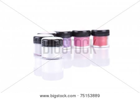 Mineral eye shadows in pink colors, isolated on white background with natural reflection
