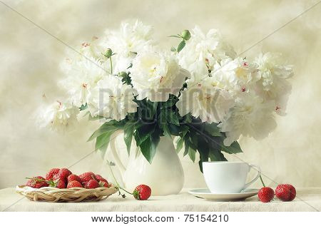 Still-life with a magnificent bouquet and a ripe strawberry