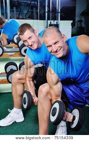 Muscular Men Exercising In A Gym