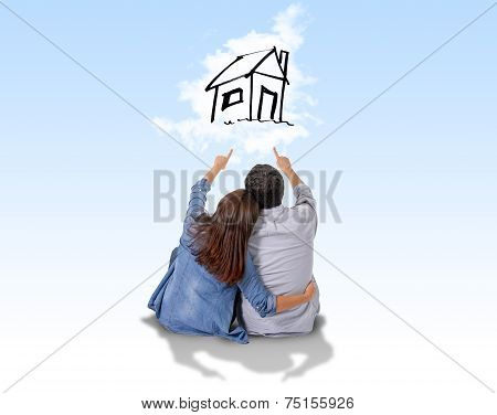 Young Couple Dreaming And Imaging Their New House In Real State