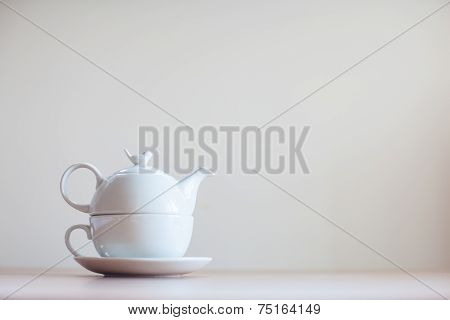 Teapot Leaning On Wooden Table
