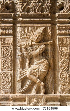 Ancient stone mural of Krishna.