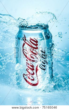 MOSCOW, RUSSIA-APRIL 4, 2014: Can of Coca-Cola Lignt in water. Coca-Cola is a carbonated soft drink sold in stores, restaurants, and vending machines throughout the world.