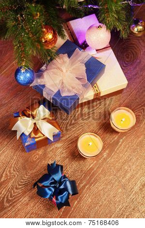Christmas gift boxes in the interior with two candle