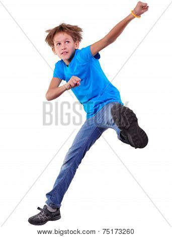 Cute Elementary Boy  Jumping And Dancing Over White