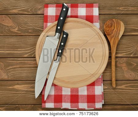Set Of Kitchen Knives And Cutting Board
