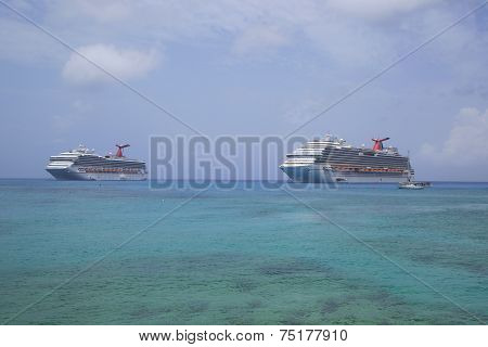 Carnival Dream  and Carnival Glory Cruise Ships anchor at the Port of George Town, Grand Cayman