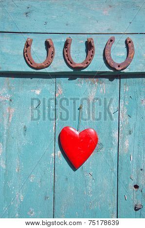 Three  Rusty Horseshoe Luck Symbol And Red Heart On Door