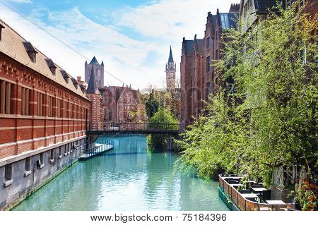 Beautiful view of river with bridge in  Ghent