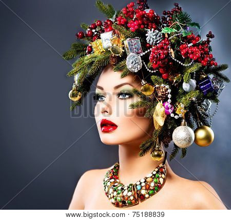 Christmas Winter Woman. Beautiful New Year and Christmas Tree Holiday Hairstyle and Make up. Beauty Fashion Model Girl dark Background. Creative Hair style decorated with Baubles
