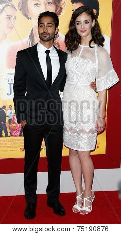 NEW YORK-AUG 4: Actors Manish Dayal and Charlotte Le Bon (R) attend