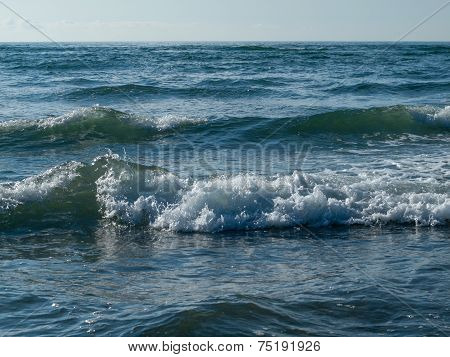 Ocean Waves Breaking On The Beach On A Clear Day