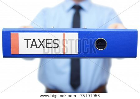 Taxes Word Is Written On The Binder