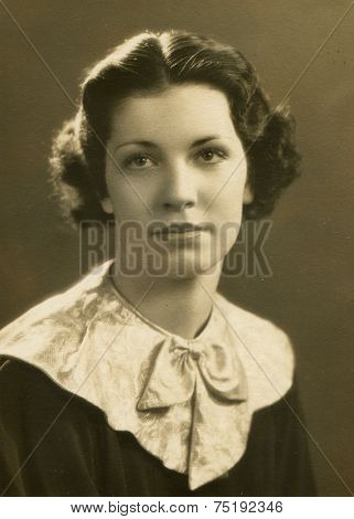 CANADA - CIRCA 1920s: Vintage photo shows studio portrait of a woman.