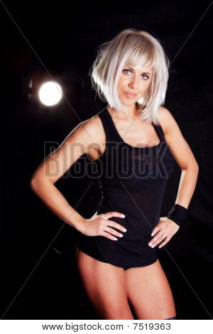 Blond Muscular Woman  Doing Fitness Exercise Over Dark