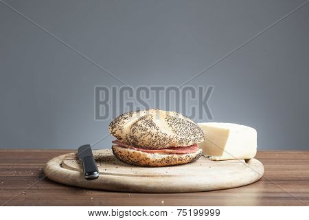 Poppy Seed Roll With Salami, Butter, Knife On Plate