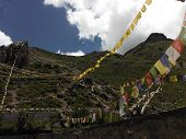 picture of premises  - Colorful prayer flags decorating the mountainous premises around the Muktinath temple complex Annapurna Himalayas of Nepal during monsoon - JPG