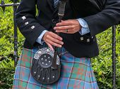pic of bagpiper  - Piper playing in the streets of Edinburgh