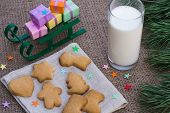 picture of flogging  - Christmas theme with floggings sled cookies and milk - JPG