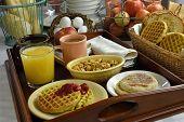 stock photo of continental food  - coffee tea juice and various breakfast foods buffet - JPG
