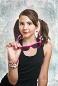 picture of teen pony tail  - Portrait of cute teen girl with pony tails and sun glasses looking at camera - JPG