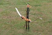 picture of longbow  - An Archery Bow and Arrows on a Metal Stand - JPG