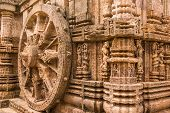 foto of chariot  - A chariot wheel carved into the wall of the sun temple at Konark - JPG