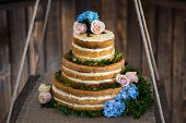 image of three tier  - brown and creamy white 3 tier wedding cake - JPG
