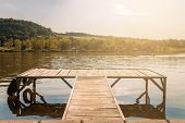 picture of pier a lake  - Pier in sunset at the lake - JPG