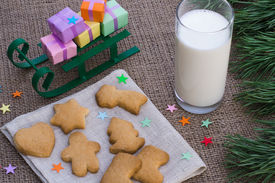 stock photo of flogging  - Christmas theme with floggings sled cookies and milk - JPG