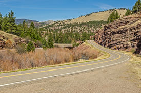 picture of mph  - Winding road with beautiful scenery and a 30 mph curve coming up on a Montana frontage road in spring - JPG
