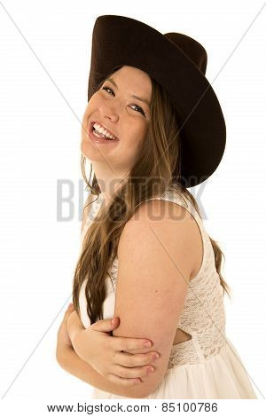 Cowgirl Wearing A White Dress With Her Arms Folded Laughing