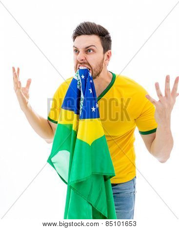 Man biting the Brazilian flag on white background