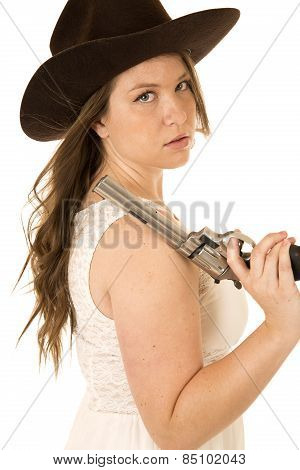 Cowgirl Looking Over Her Shoulder Holding A Big Pistol